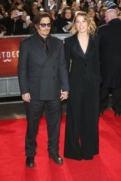 Amber Heard hasta le quiso hacer competencia a su galán, Johnny Depp.