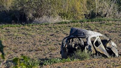 Restos del automóvil de la periodista Daphne Caruana Galizia tras...