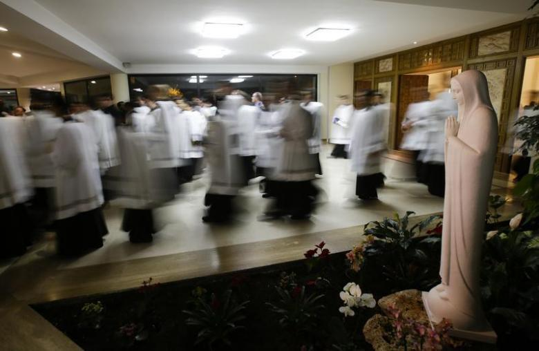 Priests leave at the end of a mass led by Father Eduardo Robles Gil, the...