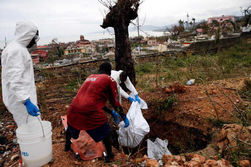 Volunteers bury the dead in Jeremie one of the hardest hit citiies in Ha...