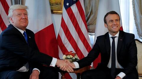 Newly-elected presidents Donald Trump and France's Emmanuel Macron shake...