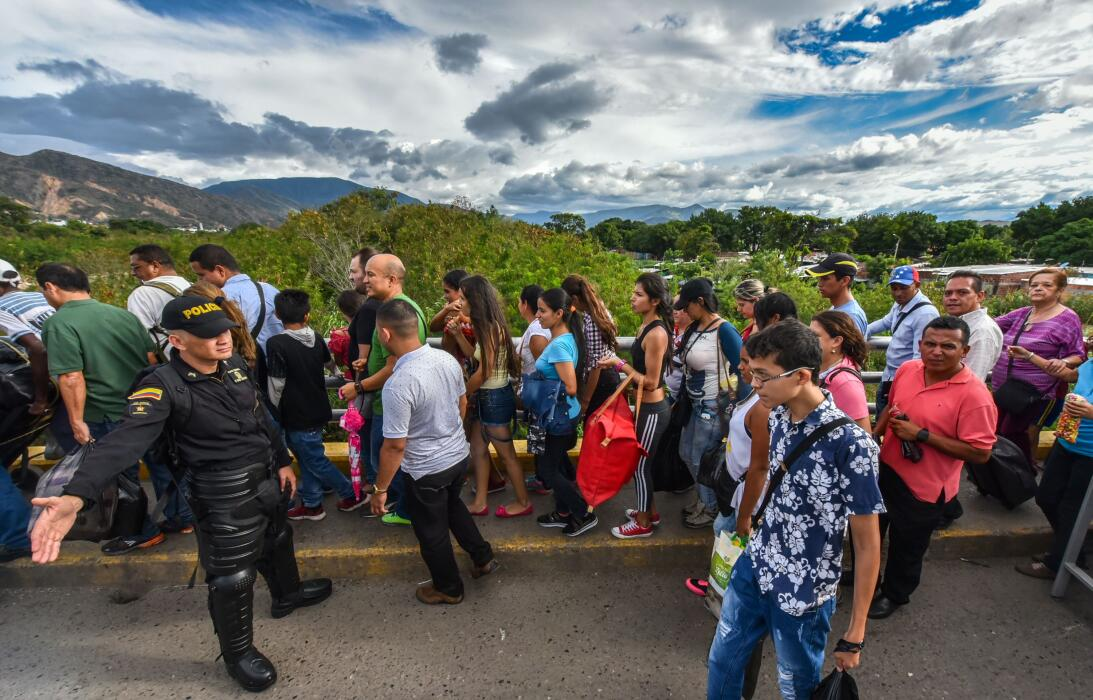 Venezuelan citizens cross the Simon Bolivar international bridge from Sa...