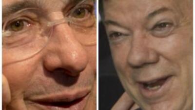 Álvaro Uribe y Manuel Santos, respectivamente ex presidente y actual pre...