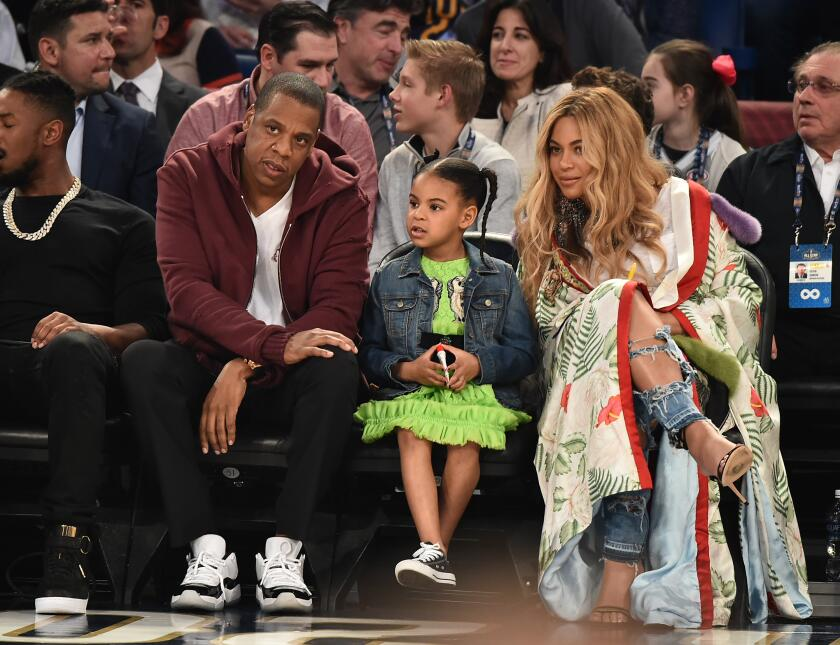 Jay Z, Blue Ivy Carter and Beyonce Knowles attend the 66th NBA All-Star...