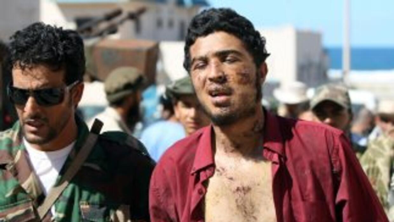 Al cabo de cuatro semanas de bombardeos y de intensos combates urbanos,...