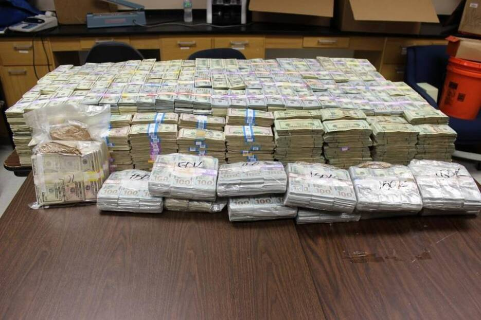 Police found so much money that they're still counting the cash.