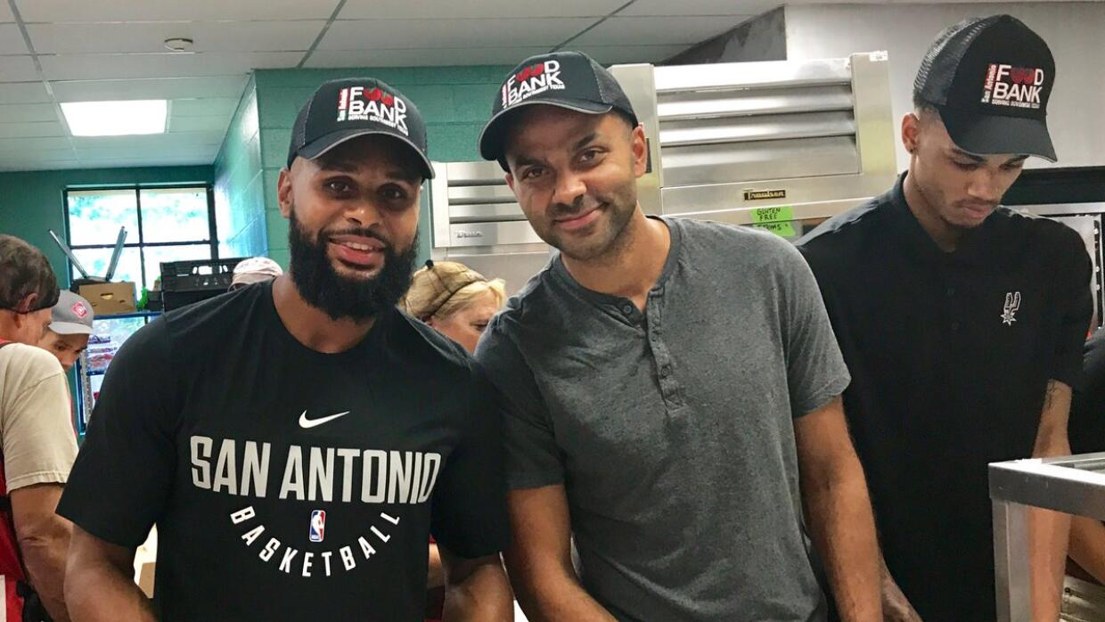 Patty Mills and Tony Parker help at the San Antonio Food Bank