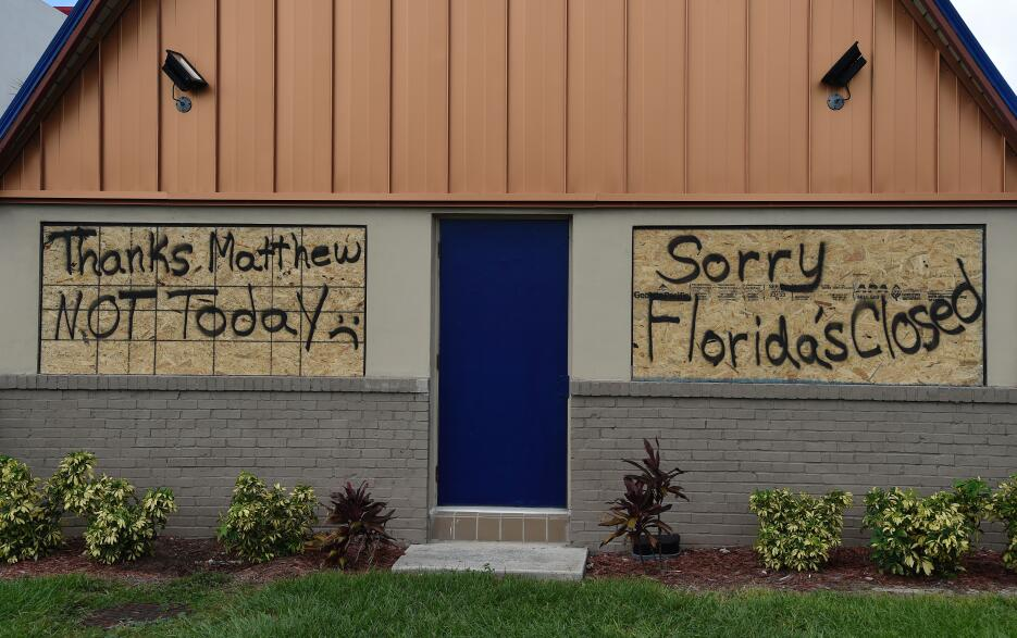 Florida residents boarded up on the eve of Matthew's arrival.