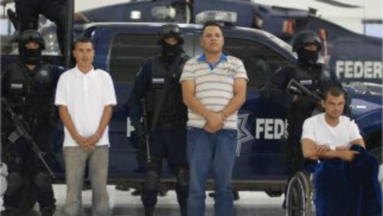 Las autoridades mexicanas presentaron a tres presuntos responsables del...