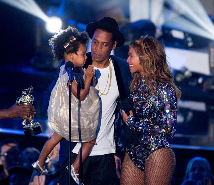 Rapper Jay Z and singer Beyonce with daughter Blue Ivy Carter onstage du...