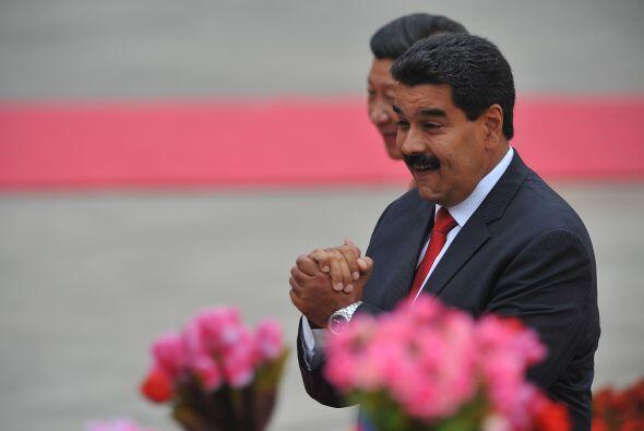 Nicolás Maduro de visita en China. Aquí, contento durante la ceremonia d...