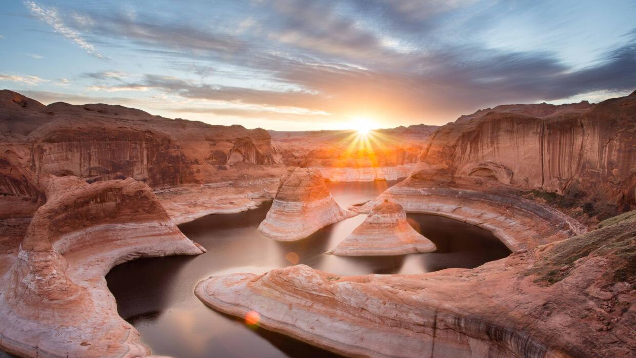 Este bello amanecer en el Área Recreativa Glen Canyon, en Utah, c...