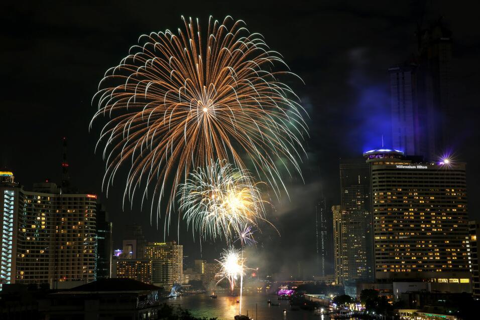 Fireworks explode over Chao Phraya River duringNew Year's celebratio...