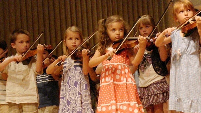 Children playing violin.
