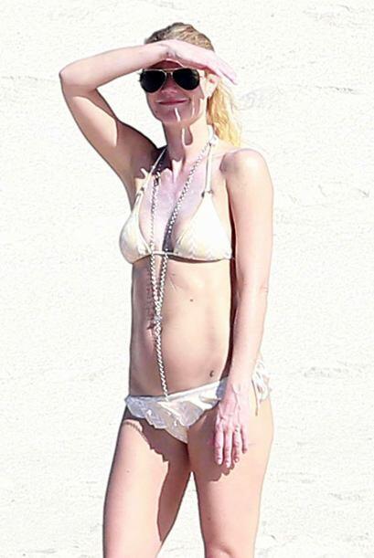 Gwyneth notando al fotógrafo.