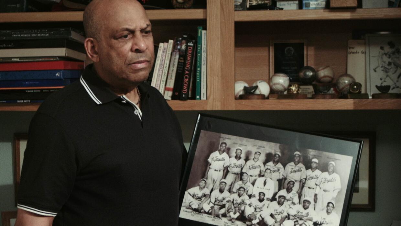 Orlando Cepeda showing off a photo of the 1937 Ciudad Trujillo team, whi...