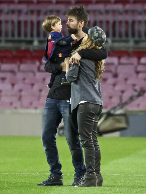 Shakira and Gerard Pique play with their children and other teammates at...