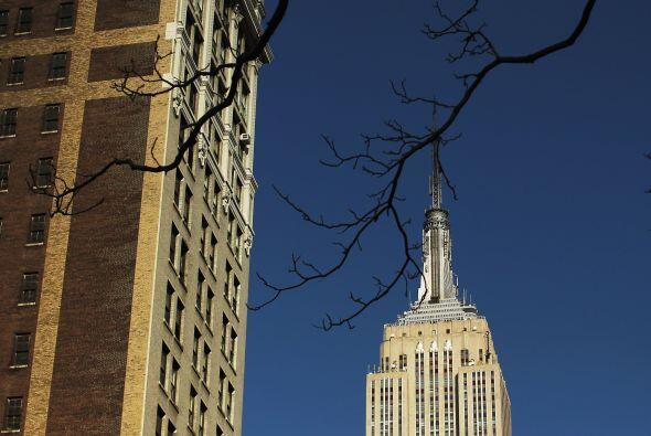 El célebre rascacielos Empire State Building, el más alto de Nueva York,...