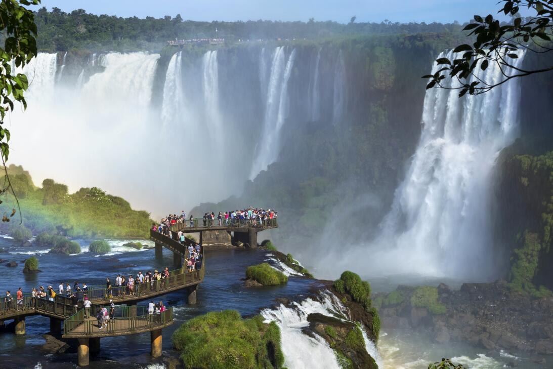 Tourists at Iguazu Falls, one of the world's great natural wonders,...