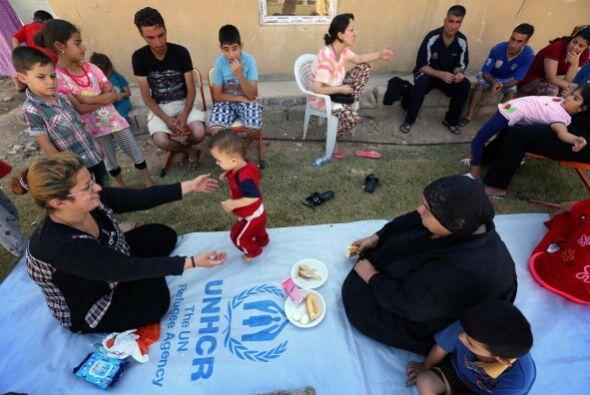 Se refugian en el jardín de la iglesia San José en las afueras de Erbil.