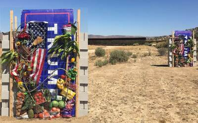 t.Rutt's anti-Trump wall with the real border wall in the background