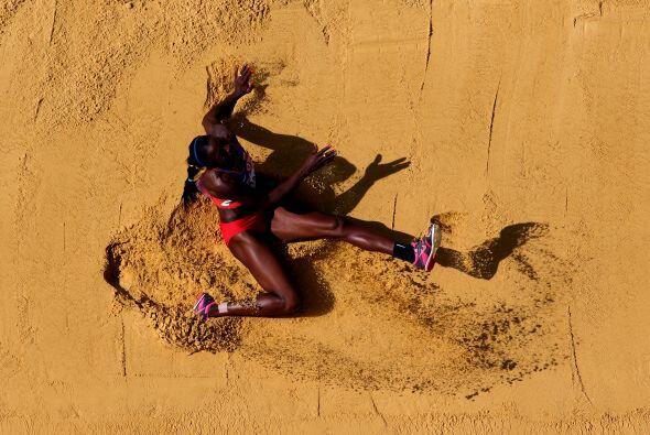La medalla dorada en el salto triple femenil fue para la colombiana Cate...