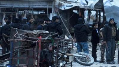 Once personas murieron al explotar un coche bomba cerca del edificio don...