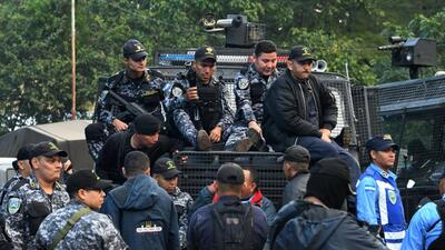 Members of Honduras National Police and police officers belonging to COB...