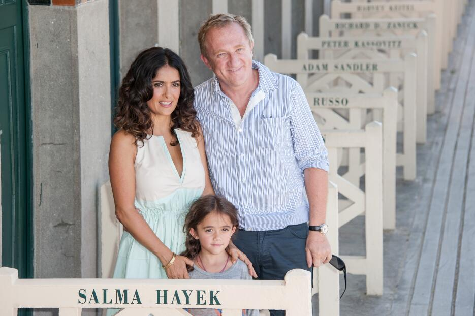 Salma Hayek poses her husband Francois-Henri Pinault with their daughter...