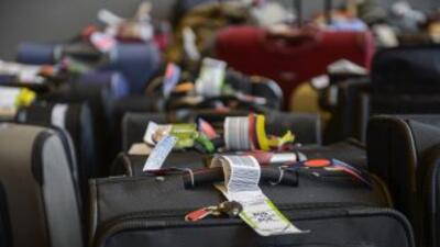 Pasajeros del vuelo accidentado de Asiana sufrieron robo de equipaje a6a...
