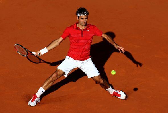 Y el serbio Novak Djokovic ante la raqueta suiza Roger Federer (foto).