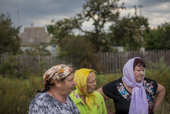 Entre rezos y lágrimas, los vecinos de Grabovo recordaron a las víctimas...