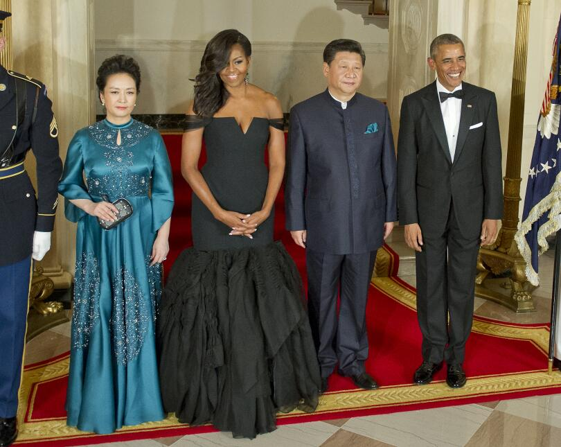 At the 2015 state dinner for China wearing Vera Wang.