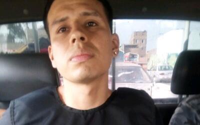 Alexander Delgado es trasladado luego de su arresto.