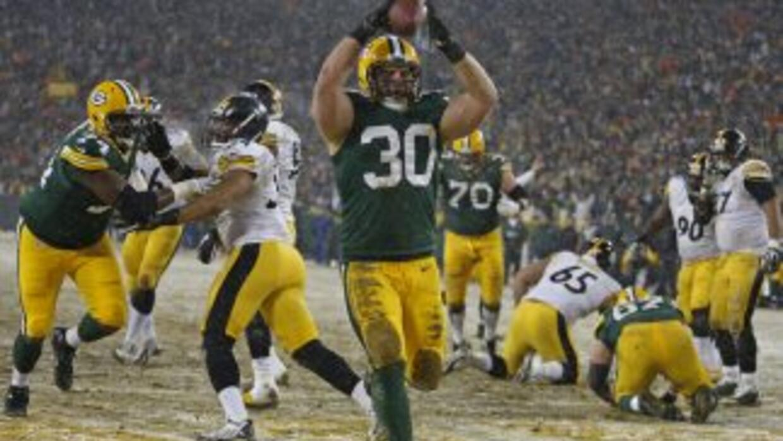 John Kuhn se queda en los Packers (AP-NFL).
