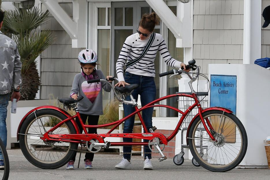 Alessandra Ambrosio Enjoys A Family Tandem Bike Ride By The Beach