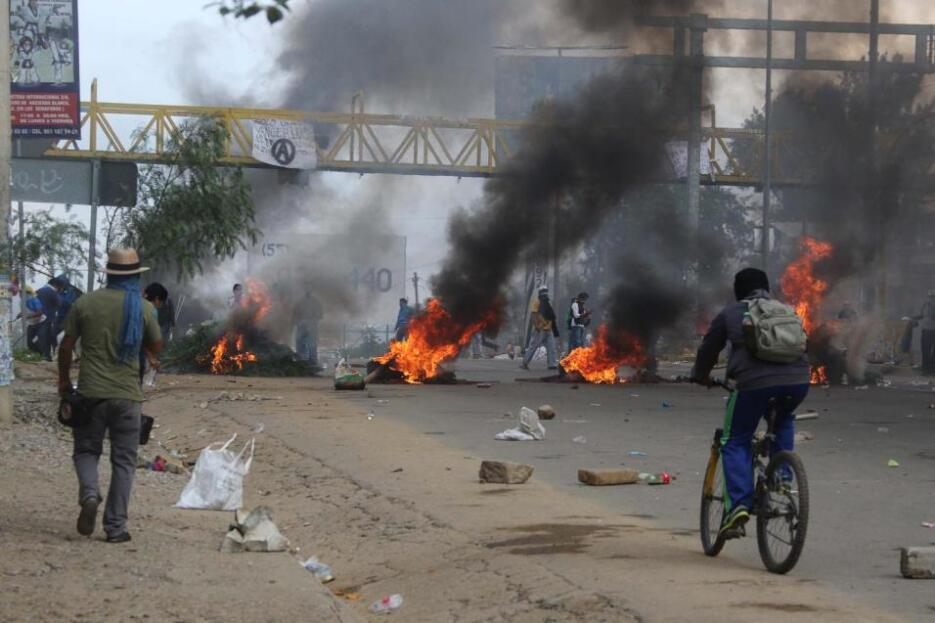 Protestors burn tires to block a federal highway in the state of Oaxaca