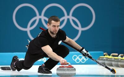 Ganó bronce en parejas mixtas de  junto a su esposa Alexandra Bri...