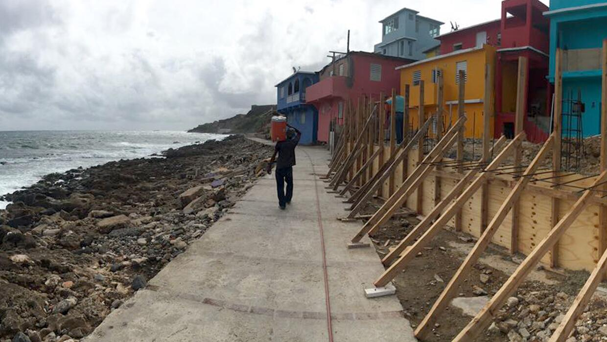 A man walks on the seafront in La Perla, a vulnerable colonial barrio in...