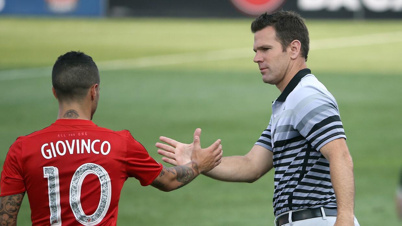 Greg Vanney, técnico de Toronto FC y su estrella Sebastian Giovinco.