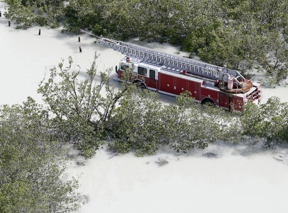 A fire truck is shown in a flooded area in the wake of Hurricane Irma, M...