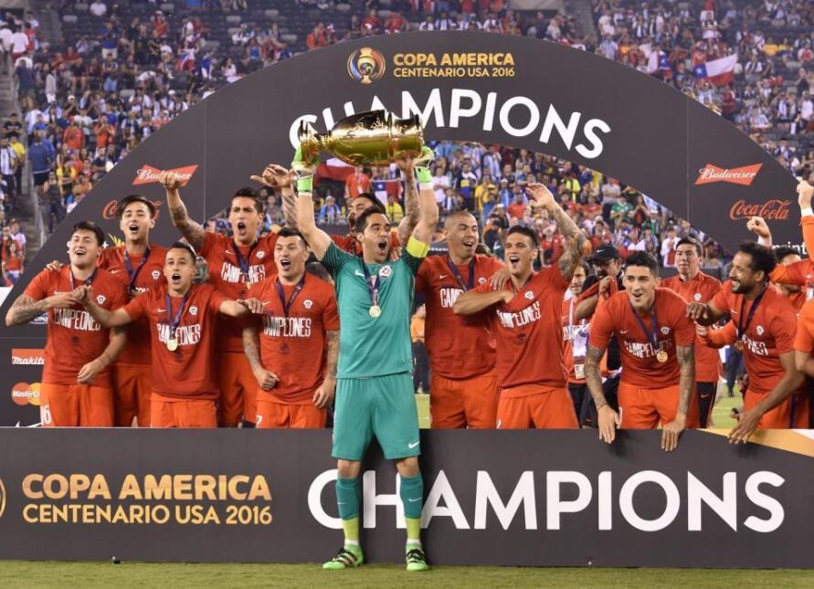 Chile's captain Claudio Bravo lifts the Copa America Centenario trophy i...