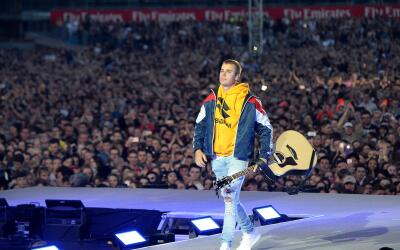 Justin Bieber plays on stage at the 'One Love Manchester' on June 4, 201...