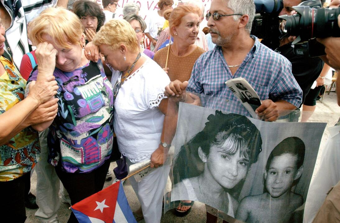 Cuban American women in front of the house where six-year-old shipwreck...