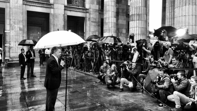 Colombian president Juan Manuel Santos addressed reporters after casting...