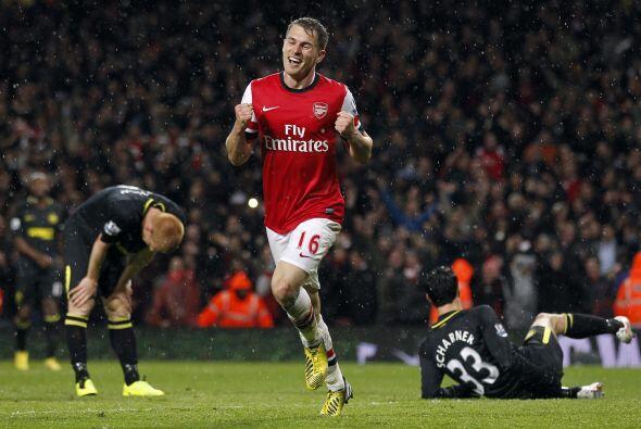 El 14 de Mayo de 2013, Ramsey le anotó gol al Wigan por la Premier Leagu...