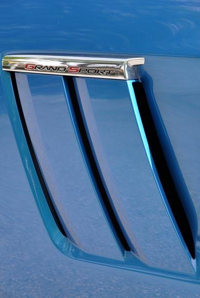 La insignia de Grand Sport se repite en algunas partes del exterior como...