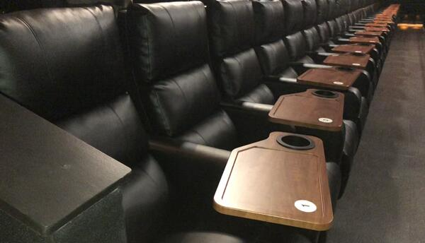 Santikos Palladium's new luxurious power recliner seats with table.