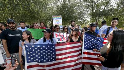 DACA supporters march to the Immigration and Customs Enforcement office...