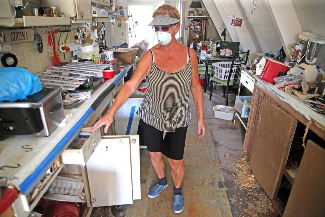 Dee Thorne walks through her home on Big Pine Key in the Florida Keys, d...